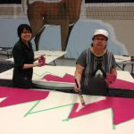 Deanna Burch and her mom, Maureen White painting in the Geese Quilt block - 2013