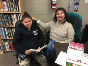 Cynthia Tribe, CTFN Librarian, with student at grand opening of library